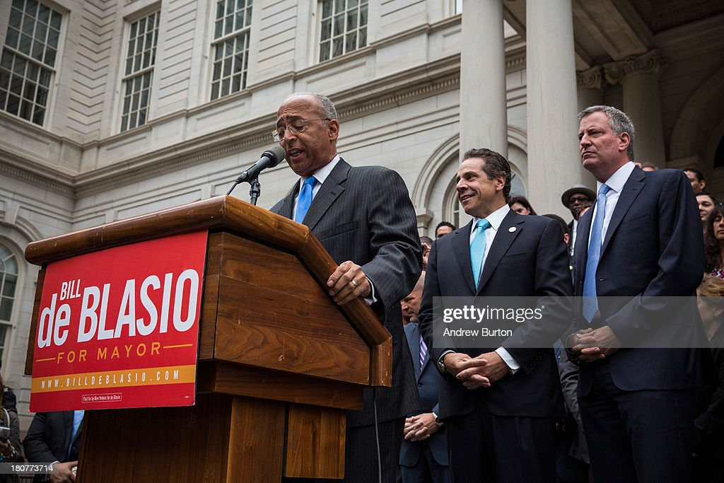 Bill Thompson (L), New York City mayoral hopeful and former New York City comptroller, concedes the Democratic party candidate position to Bill De Blasio (R), during a speech outside New York City Hall on September 16, 2013 in New York City. Thompson and De Blasio both hoped to win the democratic cadidate position for New York City. While De Blasio had a majority lead in the primary vote with approximately 40% of the votes, Thompson had hoped that he could force a run off between the two. New York Governor Andrew Cuomo (C) also attended the speech.