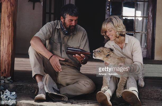 Bill Travers and Virginia McKenna play George and Joy Adamson in the Columbia picture 'Born Free' 1966 Here they feed a lion cub from a bottle