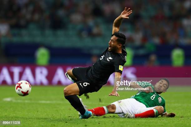 Bill Tuiloma of New Zealand is fouled by Marco Fabian of Mexico during the FIFA Confederations Cup Russia 2017 Group A match between Mexico and New...