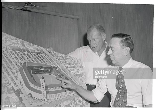 Bill Veeck left and Philip K Wrigley President of the Cubs study drawing of proposed Wrigley Field Ball Park for Los Angeles with a seating capacity...