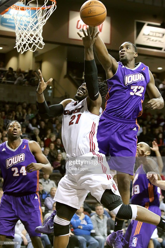 Bill Walker from the Sioux Falls Skyforce has his shot blocked by Jarvis Varnado from the Iowa Energy in their NBA DLeague game November 30 2013 at...
