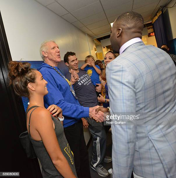 Bill Walton and Golden State Warriors assistant coach Luke Walton speak with Draymond Green before facing the Cleveland Cavaliers during Game Two of...