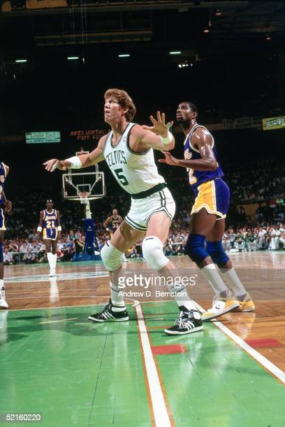 Bill Walton of the Boston Celtics boxes out for rebound against the Los Angeles Lakers during an NBA game at the Boston Garden in 1986 in Boston...