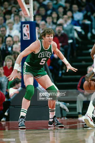 Bill Walton of the Boston Celtics defends against the Portland Trail Blazers during a game played circa 1986 at the Veterans Memorial Coliseum in...