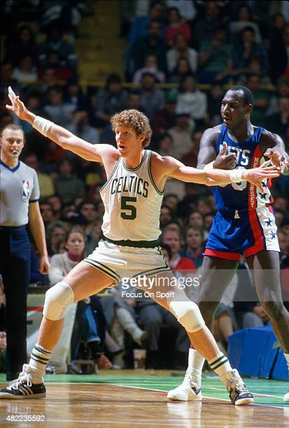 Bill Walton of the Boston Celtics gets position on Darryl Dawkins of the New Jersey Nets during an NBA basketball game circa 1986 at the Boston...