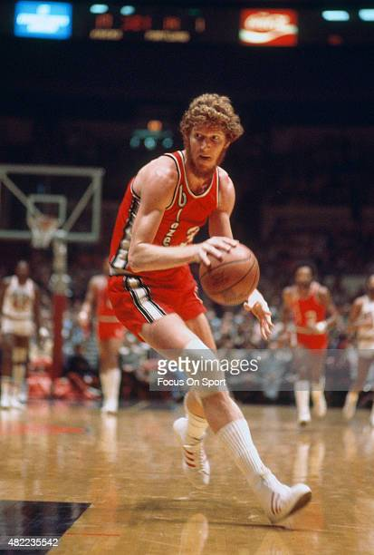 Bill Walton of the Portland Trail Blazers dribbles the ball against the New York Knicks during an NBA basketball game circa 1975 at Madison Square...