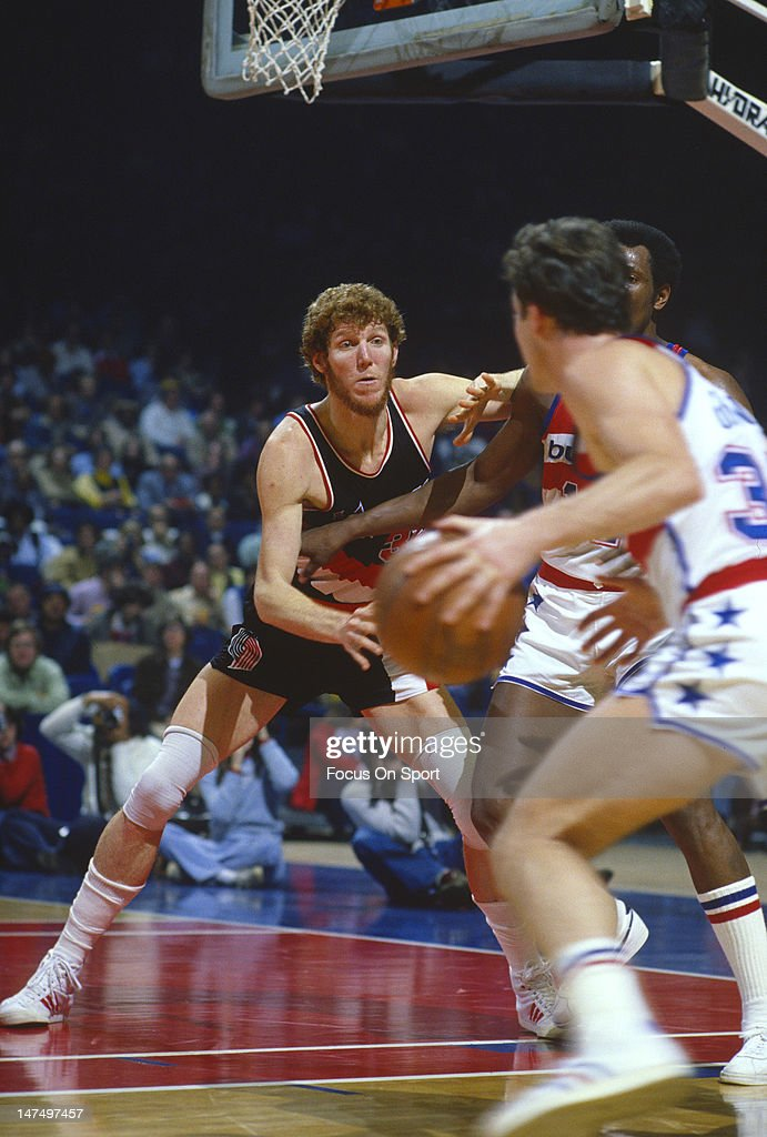 Bill Walton of the Portland Trailblazers guards Elvin Hayes of the Washington Bullets during an NBA basketball game circa 1978 at the Capital Center...
