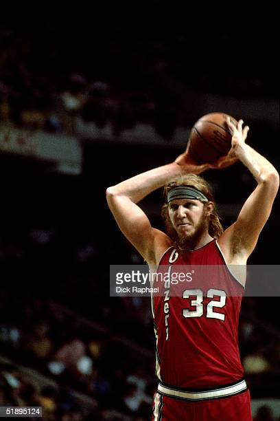 Bill Walton of the Portland Trailblazers looks to make a pass against the Boston Celtics during the NBA game at the Boston Garden in Boston...