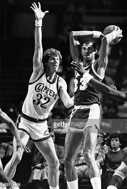Bill Walton of the San Diego Clippers defends Kareem AbdulJabbar of the Los Angeles Clippers during a game circa 1984 at the San Diego Sports Arena...