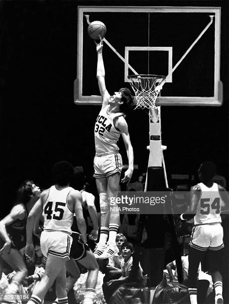 Bill Walton of UCLA goes up high to block a shot during an NCAA basketball game circa 1973 NOTE TO USER User expressly acknowledges and agrees that...