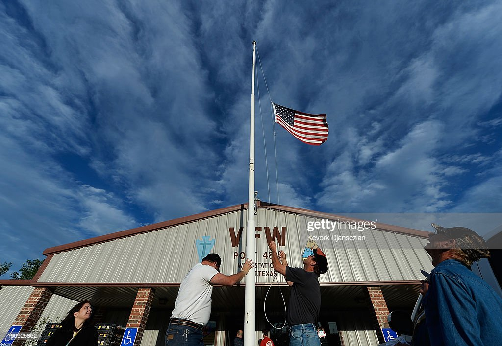 Bill Warren (R) , a member of Veterans of Foreign Wars Post 4819, lowers the U.S. flag to half staff in memory of victims of the West Fertilizer Company explosion April 18, 2013 in West, Texas. A fiery explosion that damaged or destroyed buildings within a half-mile radius ripped through the facility last night, injuring more than 160 people and killing an unknown number of others.