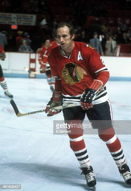 Bill White of the Chicago Blackhawks skates on the ice during an NHL game against the Montreal Candiens circa 1976 at the Montreal Forum in Montreal...