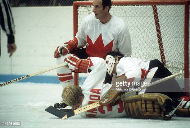 Bill White Pat Stapleton and goalie Tony Esposito of Canada are piled up in the crease during the 1972 Summit Series against the Soviet Union in...