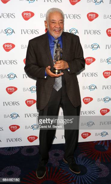 Bill Withers poses with the award for PRS Music Special International Award in the winners room at the Ivor Novello Awards at Grosvenor House on May...