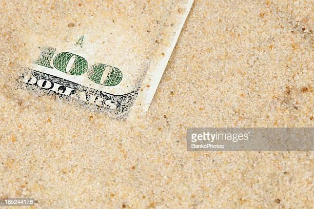 $100 Bill within Frac Sand