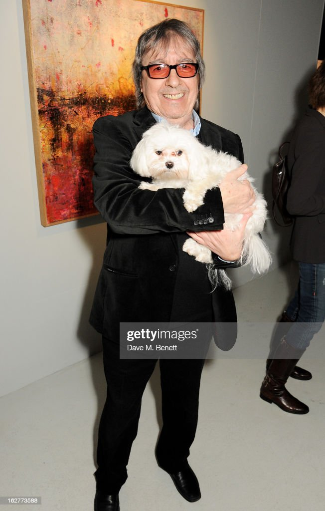 <a gi-track='captionPersonalityLinkClicked' href=/galleries/search?phrase=Bill+Wyman&family=editorial&specificpeople=157859 ng-click='$event.stopPropagation()'>Bill Wyman</a> and Frankie Benett attend a private view of <a gi-track='captionPersonalityLinkClicked' href=/galleries/search?phrase=Bill+Wyman&family=editorial&specificpeople=157859 ng-click='$event.stopPropagation()'>Bill Wyman</a>'s new exhibit 'Reworked' at Rook & Raven Gallery on February 26, 2013 in London, England.