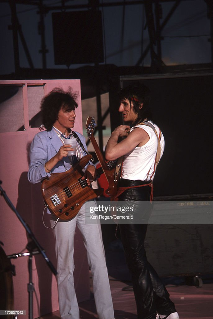 Bill Wyman and Ron Wood of the Rolling Stones are photographed are photographed on June 25-26, 1982 backstage at Wimbley Stadium in London, England.