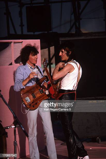 Bill Wyman and Ron Wood of the Rolling Stones are photographed are photographed on June 2526 1982 backstage at Wimbley Stadium in London England...
