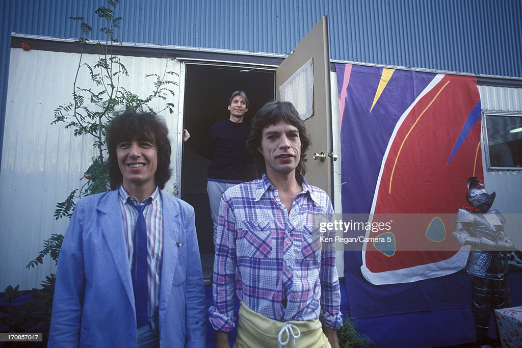 Bill Wyman, Charlie Watts and Mick Jagger of the Rolling Stones are photographed on June 25-26, 1982 backstage at Wimbley Stadium in London, England.