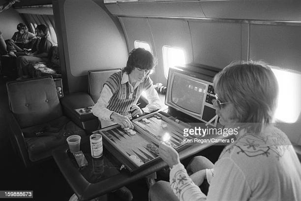 Bill Wyman of The Rolling Stones is photographed playing backgammon on the plane in 1975 in Kansas City Kansas CREDIT MUST READ Ken Regan/Camera 5...