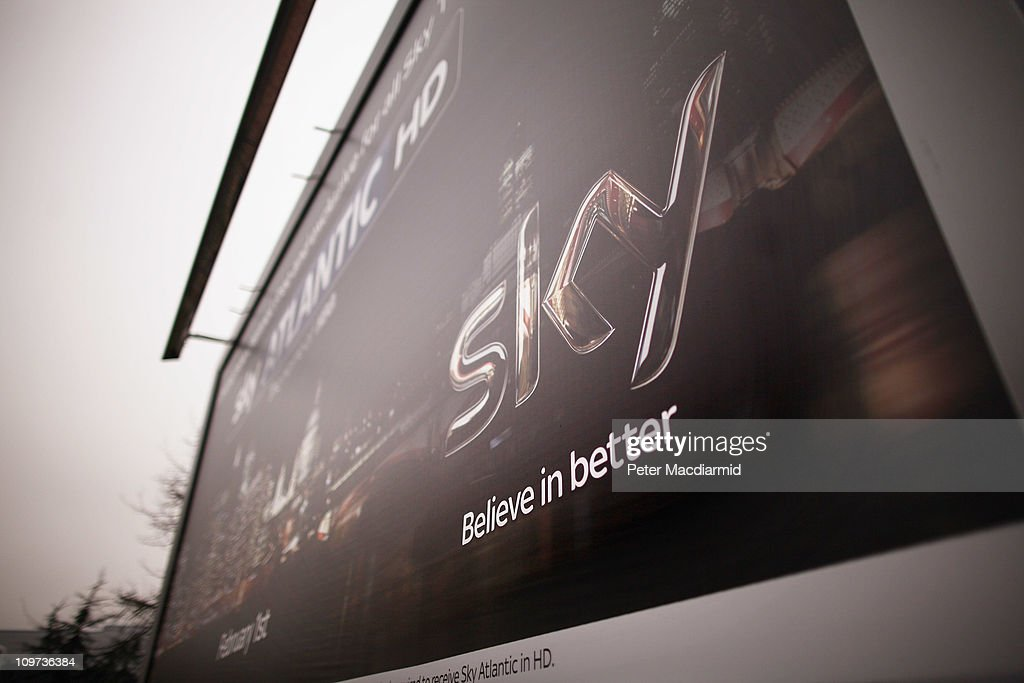 A billboard advert for Sky television is mounted outside a Sky building on March 3, 2011 in Osterley Park, England. The British government has given the go-ahead for Rupert Murdoch's News Corporation to takeover satellite broadcaster BSkyB. The deal has been allowed after News Corporation offered to spin off Sky News.
