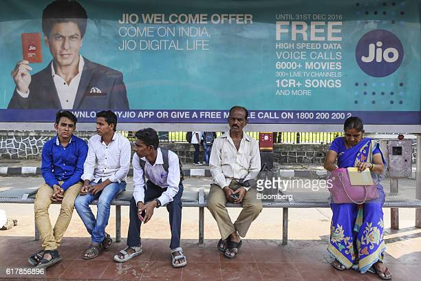 A billboard advertisement featuring Bollywood actor Shah Rukh Khan for Reliance Jio the mobile network of Reliance Industries Ltd is displayed at a...