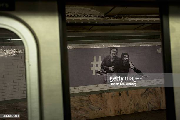 A billboard advertisement for Twitter displaying a portrait of comedians Gene Wilder and Richard Pryor hangs from a wall December 18 2016 in a subway...