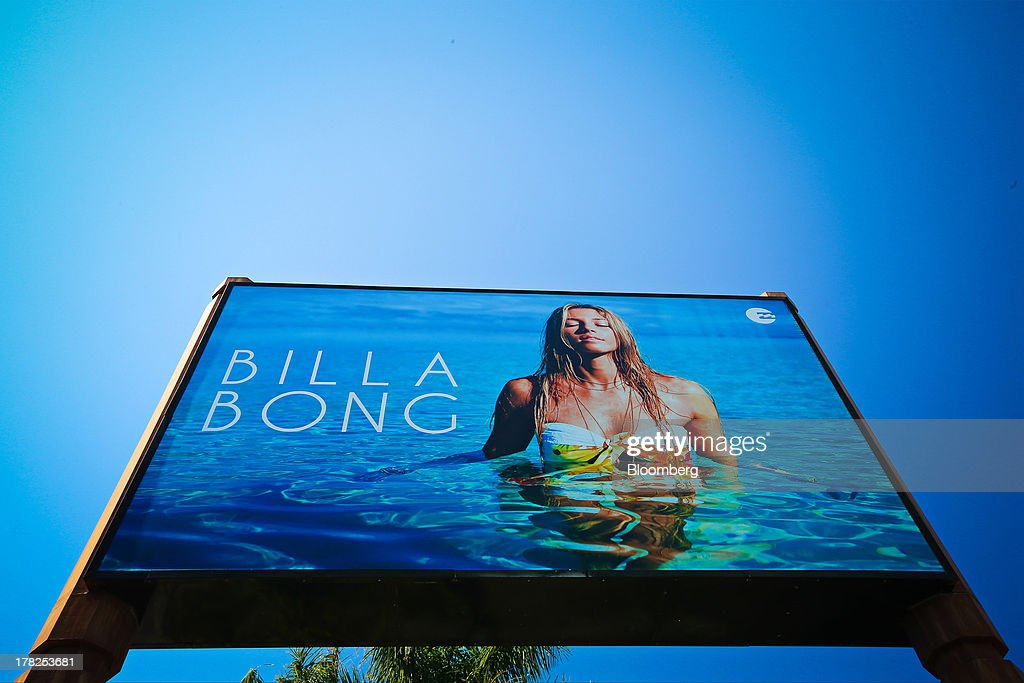 A billboard advertisement stands outside a Billabong International Ltd. retail store at the company's headquarters in Burleigh Heads, Australia, on Wednesday, Aug. 28, 2013. Billabong, the surf brand founded in 1973, helped sell Australian surfing culture worldwide and rose to a market value of A$3.84 billion ($3.45 billion) at its peak in 2007 said its 40-year-old surf brand was worthless after the companys losses tripled amid store closures, firings and a breach of debt terms. Photographer: Patrick Hamilton/Bloomberg via Getty Images