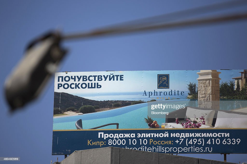 A billboard advertises luxury property for sale in Russian cyrillic script in Limassol, Cyprus, on Tuesday, April 8, 2014. Cyprus wants to shield financial flows with Russia, where it's the biggest foreign investor, as the U.S. and the European Union ratchet up sanctions in response to President Vladimir Putin's annexing Crimea from Ukraine. Photographer: Andrew Caballero-Reynolds/Bloomberg via Getty Images
