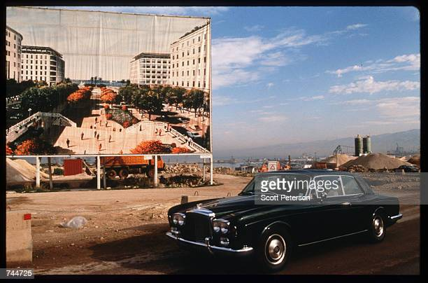 A billboard advertises new construction January 13 1997 in Beirut Lebanon The Bourse de Beyrouth was closed in 1983 during Israel's invasion and...