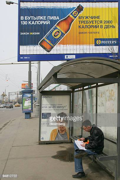 A billboard advertising Fosters beer is seen near a bus stop in Moscow Russia Tuesday April 11 2006 Scottish Newcastle Plc the UK's largest brewer...