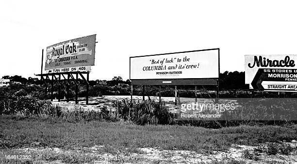 A billboard along a highway leading toward Kennedy Space Center wishes 'Best of luck' to Space Shuttle Columbia and its crew prior to its maiden...