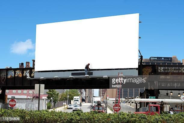 billboard and worker