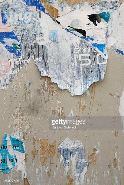 Billboard bits of torn-off poster remnants