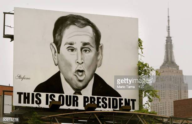 A billboard caricature of US President George W Bush by artist Stefano reads 'This is Our President' is seen in front of the Empire State Building on...