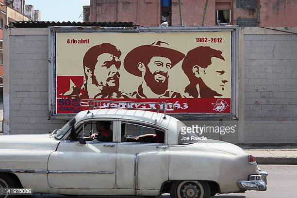 A billboard celebrating some of Cuba's revolutionary heroes Che Guevara Camilo Cienfuegos and Julio Mella hangs on a wall on the day that Pope...