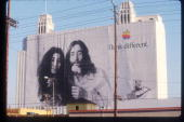 A billboard depicting John Lennon and Yoko Ono promotes Apple Computers August 1 1998 in Los Angeles CA Numerous famous and historical figures are...