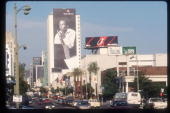 A billboard depicting Miles Davis promotes Apple Computers August 1 1998 in Los Angeles CA Numerous famous and historical figures are featured in a...