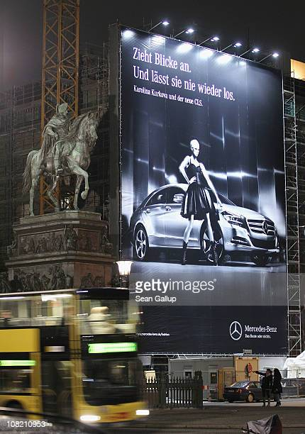 A billboard for MercedesBenz hangs near Bebelplatz during the Mercedes Benz Fashion Week Autumn/Winter 2011 on January 20 2011 in Berlin Germany