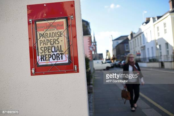 A billboard for THe Jersey Post newspapers advertises a special news report on the 'Paradise Papers' in St Helier on the British island of Jersey on...