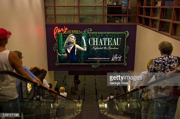 A billboard for the Paris Hotel greets visitors at Concourse D in McCarran International Airport on August 12 in Las Vegas Nevada With tourism slowly...