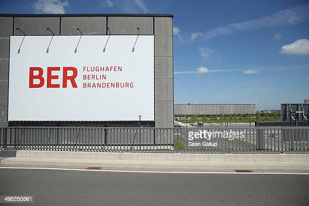 A billboard hangs on th side of a parking garage at the unfinished new BER Willy Brandt Berlin Brandenburg International Airport on June 2 2014 in...