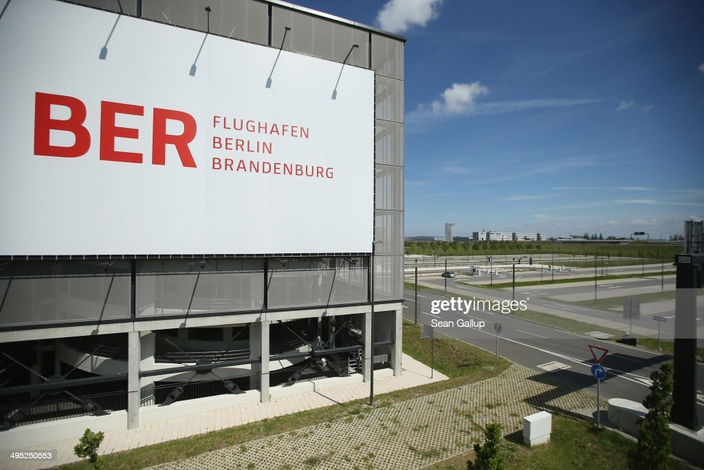 A billboard hangs on th side of a parking garage next to an empty parking lot at the unfinished new BER Willy Brandt Berlin Brandenburg International Airport on June 2, 2014 in Schoenefeld, Germany. The airport, which is years behind schedule with no opening date yet in sight, has now been hit by a corruption scandal involving head technician Jochen Grossmann, who is accused of demanding a EUR 500,000 bribe from a contracting firm. The airport's governing body is meeting today and has designated a task force to determine whether Grossmnn might have demanded bribes from other companies as well.
