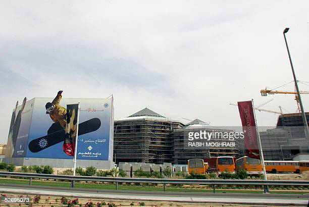 A billboard in front of the Mall of the Emirates under construction in Dubai advertises the Middle East's soontobe only indoor ski resort and the...