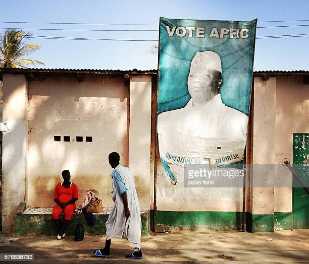 Billboard of Gambia's President Yayah Jammeh in a Gambian village The letters on the billboard have been torn ironically to no longer read as...