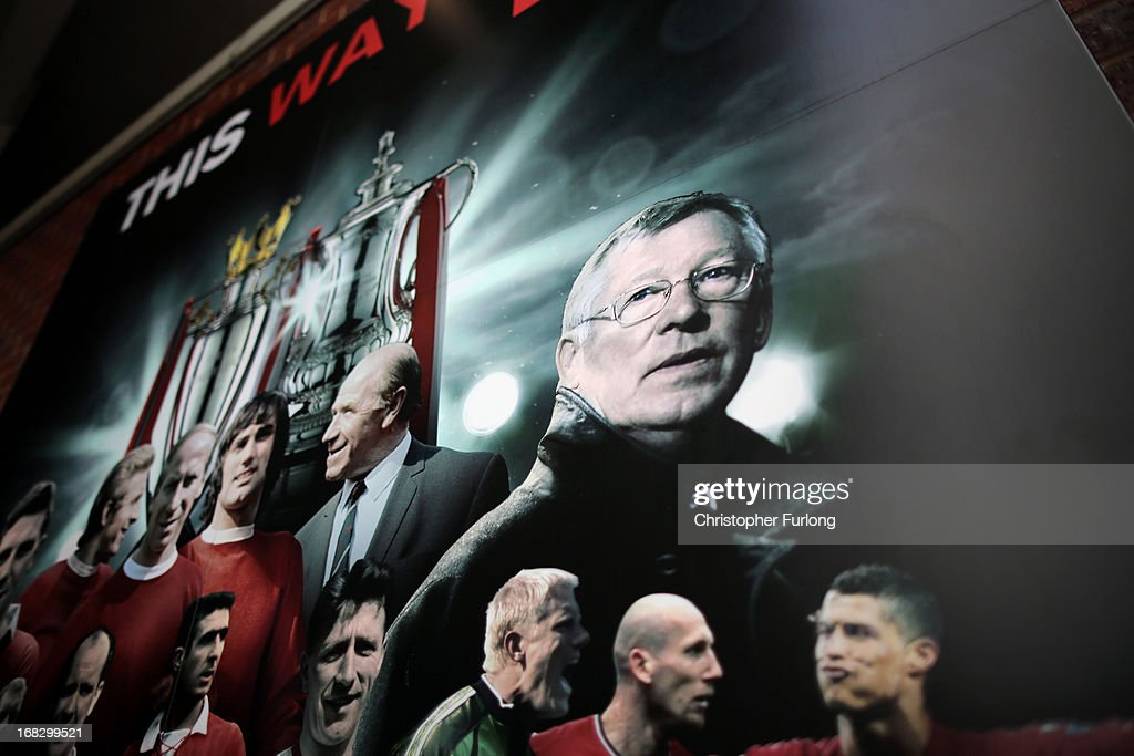 A billboard of Manchester United players and manager Sir <a gi-track='captionPersonalityLinkClicked' href=/galleries/search?phrase=Alex+Ferguson&family=editorial&specificpeople=203067 ng-click='$event.stopPropagation()'>Alex Ferguson</a> stands outside Old Trafford on the day he announced his retirement as club manager on May 8, 2013 in Manchester, England. Sir <a gi-track='captionPersonalityLinkClicked' href=/galleries/search?phrase=Alex+Ferguson&family=editorial&specificpeople=203067 ng-click='$event.stopPropagation()'>Alex Ferguson</a> announced today that he is retiring as manager of Manchester United after 26 years.