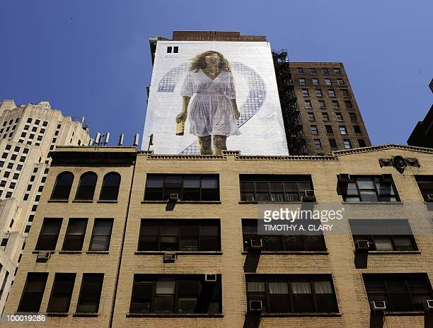 A billboard of Sarah Jessica Parker starring as Carrie Bradshaw is painted on the side of a building in New York May 20 2010 to promote the new movie...