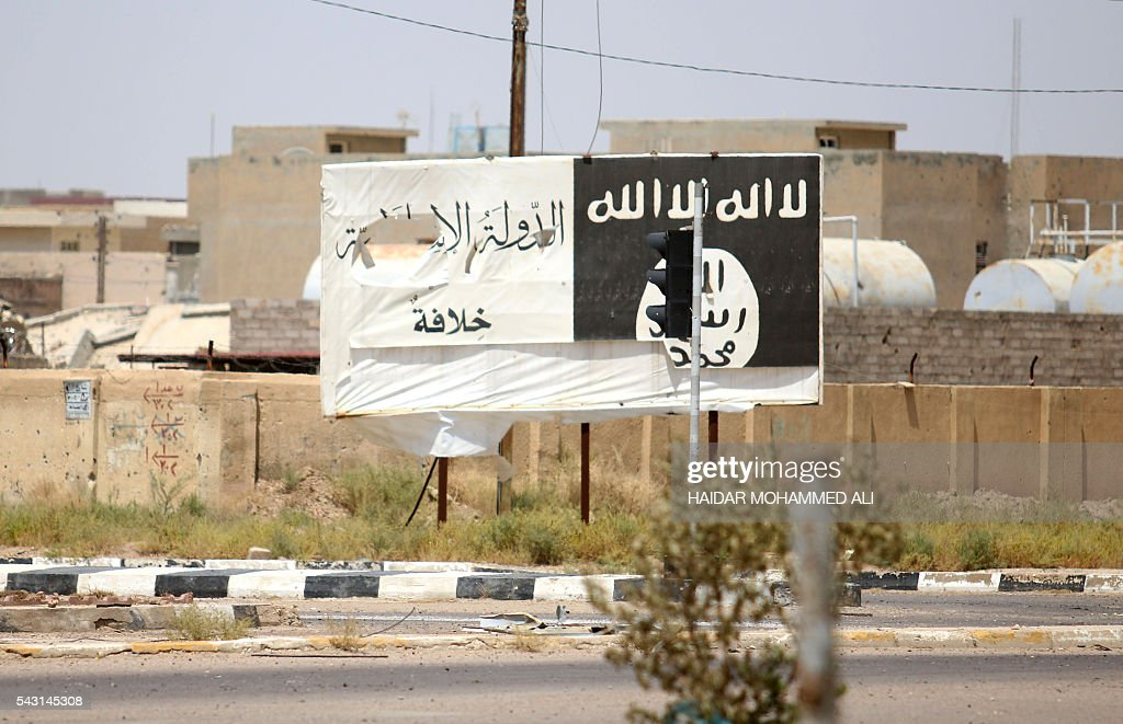 A billboard of the Islamic State group is seen in Fallujah, 50 kilometres (30 miles) from the Iraqi capital Baghdad, after Iraqi forces retook the embattled city from the jihadist group on June 26, 2016. Iraqi Prime Minister Haider al-Abadi urged all Iraqis to celebrate the recapture of Fallujah by the security forces and vowed the national flag would be raised in Mosul soon. While the battle has been won, Iraq still faces a major humanitarian crisis in its aftermath, with tens of thousands of people who fled the fighting desperately in need of assistance in the searing summer heat. ALI