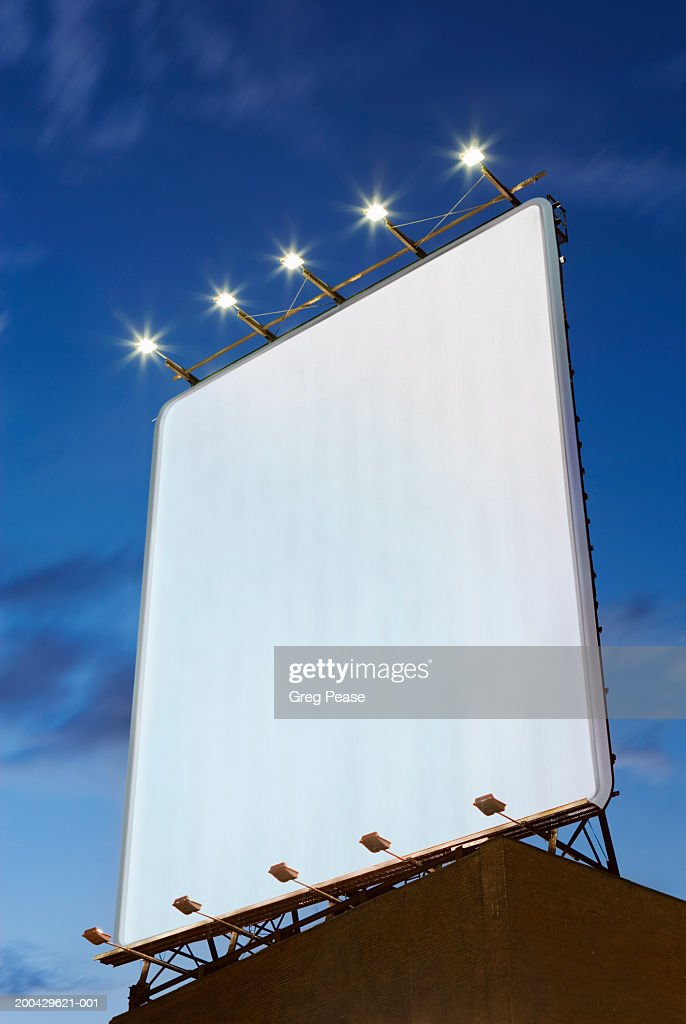 Billboard on rooftop, low angle view, dusk : Stock Photo
