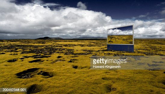 Billboard on volcanic plain : Stock Photo